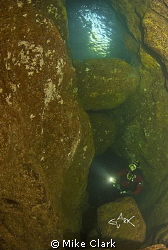 diver exploring Tyes Tunnel, St. Abbs by Mike Clark 